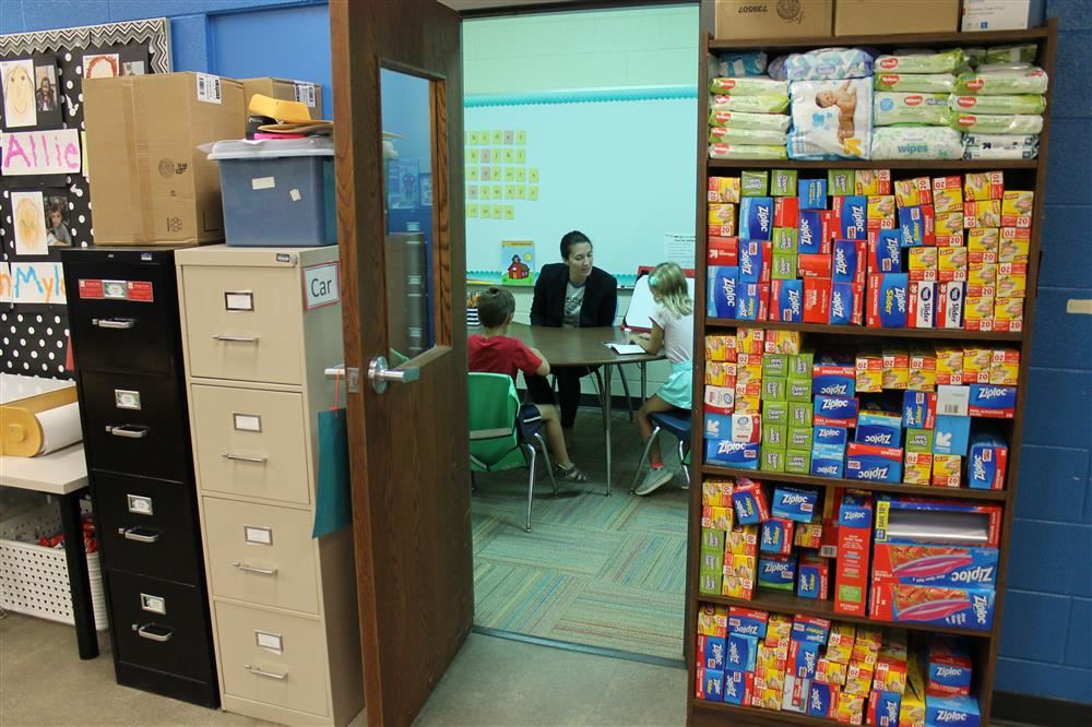 Photo of reading lesson in storage area
