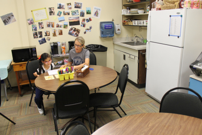Photo of instruction being done in staff lounge.