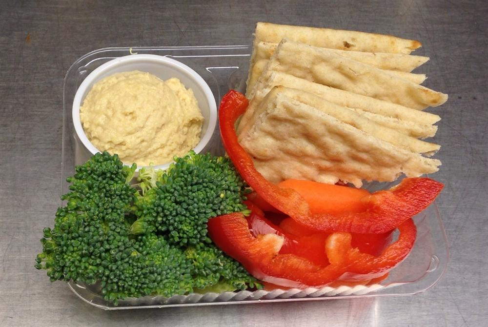 Hummus, pita wedges and vegetables served in Worthington